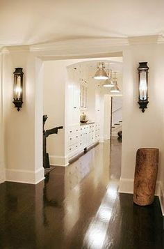 Baseboard height, design & color.  Wall of cabinetry (wall with refrigerator on it in our house).  Light fixtures in hall. Dark wood floors.