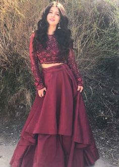 Charlie Chauhan in Kalki maroon double layer skirt with embroidered crop top blouse. For order whatsapp us on wedding outfits wedding dress wedding dresses lengha lehnga sabyasachi manish malhotra Party Wear Indian Dresses, Designer Party Wear Dresses, Indian Gowns Dresses, Indian Fashion Dresses, Dress Indian Style, Indian Wedding Outfits, Indian Designer Outfits, Party Dresses, Indian Skirt