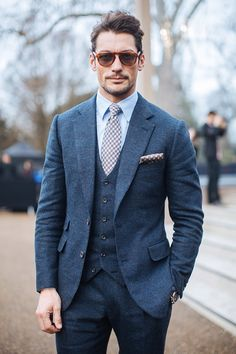Blue 3 piece suit, light blue shirt, patterned tie, and polka dot pocket square