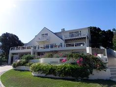 On the Garden Route in Knysna, Amanzi Island Lodge is on the edge of the beautiful Knysna Lagoon, this spacious beach house offers luxury, comfort, tranquillity and spectacular views.