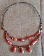 Beautiful glass beads in two rows . Adjustable length in leather