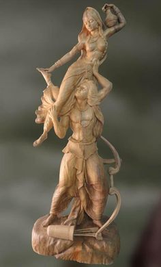 Wood sculpture of Arjuna and Chitrangada in romance - Artisans Crest