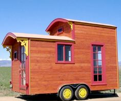 This would be my ideal kind of tiny house - vardo style with a loft. Just imagine it being 24 feet. Note straight walls for easier framing and the curved roof for that gypsy feel.