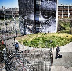 Juxtapoz Magazine - JR pastes Rikers Island Jail