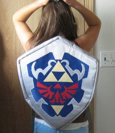 Hylian Shield Back Pack by Missaninty.  How come I didn't have this backpack when I was in school????