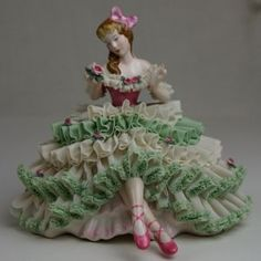 Dresden Lace.. Lady Figurine-I remember my sister broke one when we were little and tried to hide it under the carpet. There was a big lump there. Boy was Mom mad!