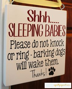 """Do you have a sticky note on your front door requesting visitors not to  knock but doesn't seem to get noticed? Or does your UPS person ring the  bell when they drop something off? Well this sign will clearly let visitors  know what you need and makes a great gift Baby Shower gift or gift for new  parents too.   DESCRIPTION: The sign measures approximately 7"""" Tall by 7"""" Wide. (ribbon not included) The board is hand painted and the text is a high performance vinyl that  will not peel. 2 ..."""