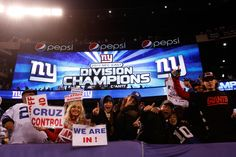 Fans celebrate after the New York Giants defeated the Dallas Cowboys at MetLife Stadium on January 1, 2012