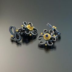 Sapphire, silver and gold cufflinks.