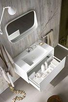 Mobile lavabo moderno / in Corian® / con armadietto integrato