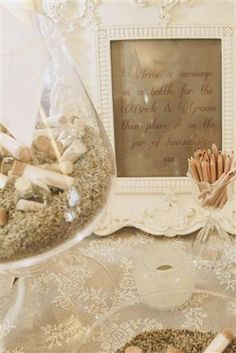 In lieu of a guestbook, guests wrote notes on slips of paper, rolled them into cork topped glass bottles and placed them in large bowls filled with dried lavender buds.