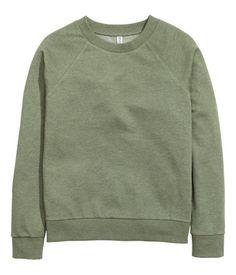 Khakigrün. Langarmshirt aus Sweatstoff mit Bündchen an Ärmeln und Saum.