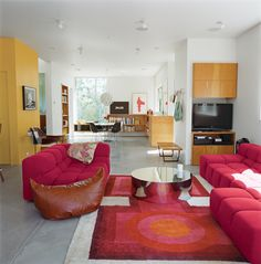 Grunbaum was unafraid of a little color, as his living room (above) proves. It includes a coffee table by Mockett and a Tufty-Time sofa by Patricia Urquiola for B&B Italia.