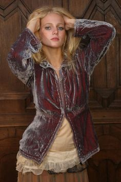 the jacket's multicolor velvetness, and the lace peeking out the bottom on her shirt.