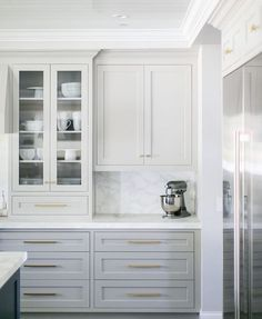 White and grey kitchen cabinets with brass hardware. Home design decor inspiration ideas. White and grey kitchen cabinets with brass hardware. Home design decor inspiration ideas. Light Gray Cabinets, Grey Kitchen Cabinets, Painting Kitchen Cabinets, White Cabinets, Kitchen Countertops, Kitchen Grey, Grey Cupboards, White Countertops, Island Kitchen