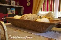 A large bread dough bowl filled with pumpkins in dining room - very Cottagey! @adelightsomelife.com