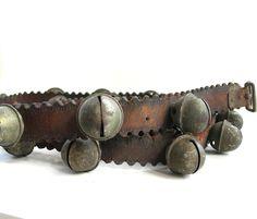 Antique Sleigh Bells -- Jingle Bells on Long Leather Strap -- 24 Brass Bells. $125.00, via Etsy.