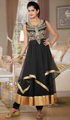 Lighten up the surrounding with your grace owning this black net and tissue layered Anarkali suit. The ethnic lace and stones work in dress adds a sign of magnificence statement to your look. #NewDesignerDress