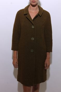 This vintage 1950s coat is made of textured olive green wool, with a nubby feel to it. #1950s #vintagecoat #btmvintage Shop now at: www.btmvintage.com