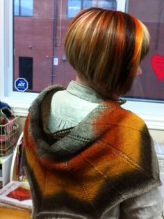 I love Wise Hilda's idea.  Matching one's hair to one's shawl.  Funky knitting!