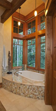 I love the natural wood trim with the windows, but would want pull down shades and a bigger tub with less tile. Bathroom Inspiration, Home Decor Inspiration, Bathroom Ideas, Dream Bathrooms, Beautiful Bathrooms, Natural Wood Trim, Rustic Bathroom Designs, Rustic Contemporary, My Dream Home