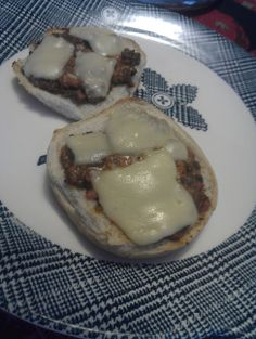 Elementary School Pizza Burgers: 1/2 lb. Bologna [or spam] (cut into tiny cubed pieces). 12-14 oz american cheese (cut into tiny cubed pieces). 1 lb. browned ground beef. 1 1/2 tsp sage. 2 1/2 tsp oregano. 1 tsp. dry parsley. 12 1/2 oz spaghetti sauce [or tomato sauce] Mix together, Put on open bun (top with extra cheese if you'd like) at 375 for 10 mins