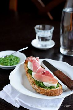Bruschetta with Mozzarella, Prosciutto and Arugula Pesto.