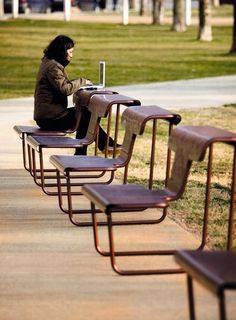Urban benches with multiple functions - El Poeta by BD Barcelona. Seat facing one way, turn around and it becomes a desk or table.: