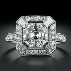 The cut & clarity of this center stone is just phenominal... see how it just goes forever?!  ~LangAntiques.com~