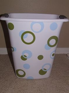 Trash can with vinyl embellishments - I need to break out my Cricut & attack Logan's boooring hamper!