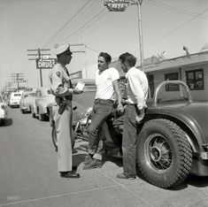 """Phoenix in 1953. """"Photographs show teenagers, mostly male, participating in the Maricopa County, Arizona, programs for teenage delinquent drivers. Includes boys working at Juvenile Farm; teens attending Attitude School; policeman with boys and their hot rods; teens driving on Phoenix streets."""" Photo by Earl Theisen for the Look magazine assignment """"How to Tame Teenage Drivers."""""""