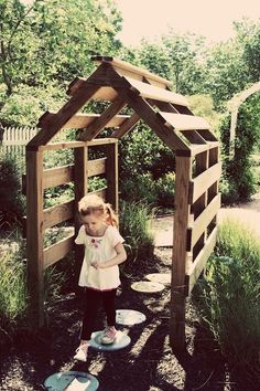 Make a simple outdoor play house from pallets - would be great with a mud pie kitchen inside!