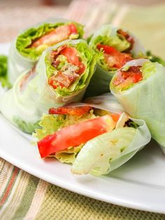 BLT Summer Roll Recipe - The classic BLT reconstructed and offered in new form -- in a Summer Roll recipe with Avocado - these are made with only six ingredients and 30 minutes and make for the perfect appetizer, lunch or light dinner. No bread to distract you from the full flavors of the real stars in the standard sandwich. Low carb, paleo, dairy free and gluten free.