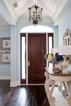Exterior Doors | dark stained door with double sidelites accented with light turquoise walls | Bayer Built Woodworks