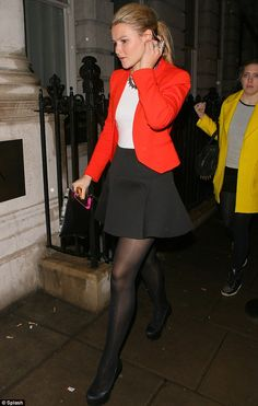 Looking hot: Made In Chelsea's Amber Atherton looked red hot in a brightly-coloured tailiored jacket and a little black mini skirt