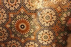 An intricately etched ceiling in Morocco. The patterns draw from different religons.there is a star representing the star of David for Judaism, there is a crossr for Christianity