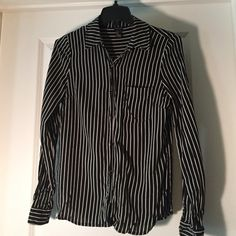 Pinstripe Button Down with Front Pocket Black cotton button down with semi-small white stripes and gold detailing on the buttons. Can be work buttoned for work or left open with a T-shirt for causal days. Forever 21 Tops Button Down Shirts