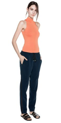 PINACLE KNIT POLO - by Dion Lee #Formfitting #sleeveless #tank #turtleneck #women #apparel #orange