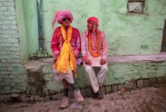 Indian villagers chat in the village of Jaav, 113 miles south of New Delhi, March 21. (KevinFrayer/Associated Press