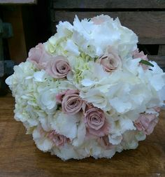 Simple hand tied bridal bouquet of white hydrangea and mentha roses.