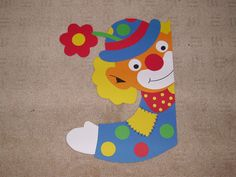 Fenstergucker Clown mit Blume