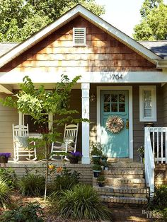Many Craftsman-style homes are fairly neutral in color scheme and material selection, so a front door can be used to offer contrast. Here, bright turquoise offers a stamp of vivid color to this front door, styled with the multiple window panes of the style's signature doors.