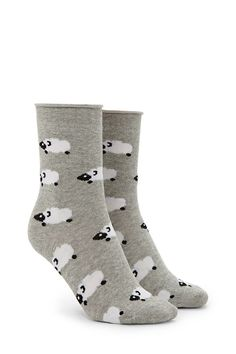 A pair of knit crew socks featuring an allover sheep pattern.