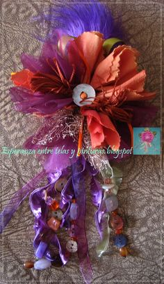 Broche flor naranja