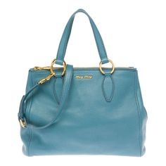 This luxurious leather Miu Miu bag is a perfect staple for work or travel. 41d8bb453f3bf