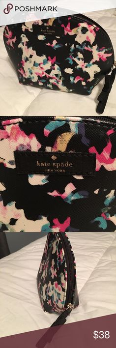 """Kate Spade cosmetic bag Kate Spade cosmetic bag.  Black with pink, cream, and turquoise flowers.  EUC.  No signs of any wear or use.  7 1/2""""W x 5""""H x 2 1/2""""D. kate spade Bags Cosmetic Bags & Cases"""