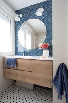 Small bathroom renovations 758856605949843353 - A small bathroom with blue metro type tile and round mirror Source by sfmrclement Blue Bathroom Decor, Yellow Bathrooms, Bathroom Interior Design, White Bathroom, Bathroom Fixtures, Bathroom Accessories, Small Bathrooms, Bathroom Ideas, Seashell Bathroom