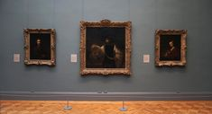 View of a Met gallery wall showing three masterpiece paintings by Rembrandt