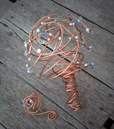 It's a wedding bouquet and matching boutineer made from recycled copper. You'll want to aim carefully when tossing that sucker over your shoulder.