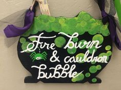 """""""Fire burn and cauldron bubble"""" sign made by adults with special needs."""